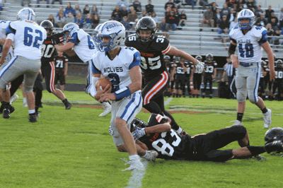 WHA quarterback Riley Welk breaks a tackle to pick up a nice gain on this first-half run. The senior finished the game with 129 yards rushing.
