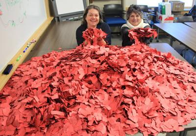 Pictured are Chamber employees Roxie Parks (left) and Cindy Wannarka with all the red tickets from local businesses.