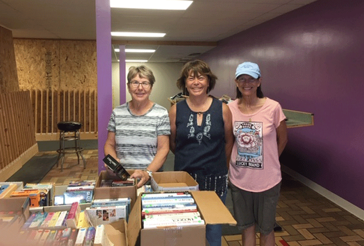 Kathy Suker (from left), Betty Baker and Maureen Seliski sorting books for the book sale.