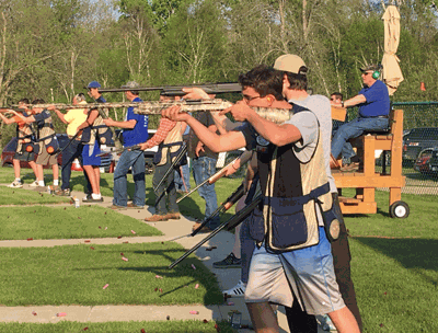 The Wolves Trapshooting Team and parents lined up for a game of Annie Oakley.