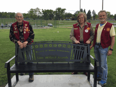 Pictured with the newly-installed bench are (from left) Treasurer Carl Berg, Secretary Sherry Kiisa and President Gary Walworth.