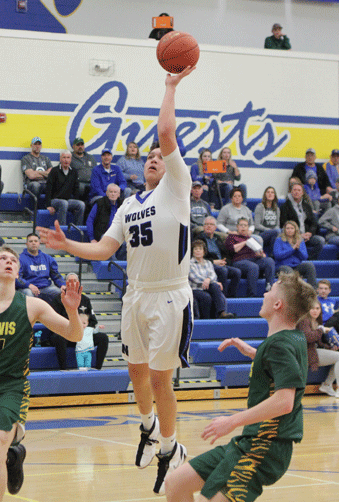 TJ Smith puts up this shot in the first half of the Wolves' game with Nevis.