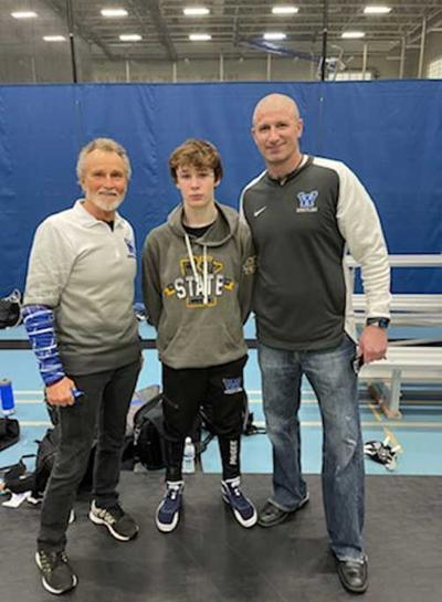 Dawson McGee at the State Wrestling Meet with coaches Gary Walworth (left) and Colby Marich.