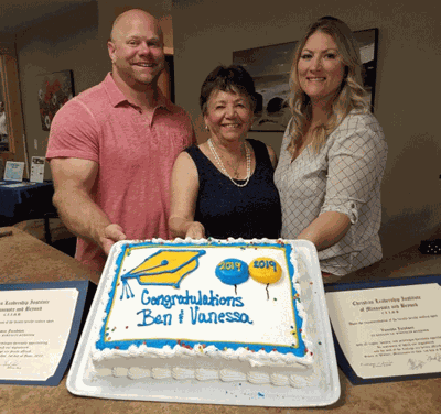The Rev.Marcille Braman (center) with Ben and Vanessa Jacobson after the two received their diplomas in Biblical Studies.
