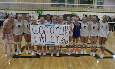 Ally Sea (center) and the rest of the Lady Wolves celebrate after the senior recorded her 1,000th dig in a win at Nevis.