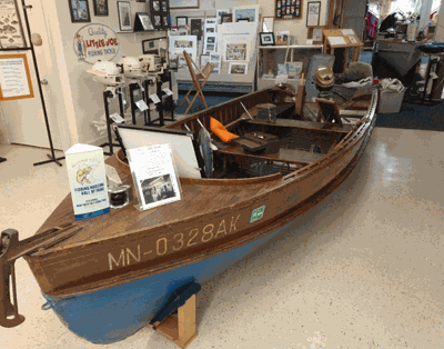 A wooden boat display at the fishing museum