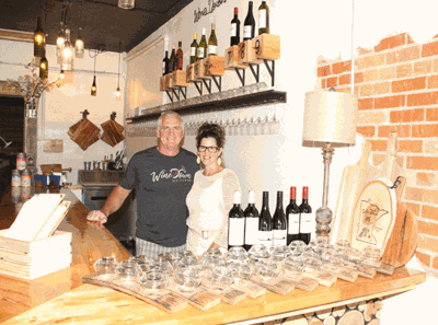 The WineDown Wine Bar owners are Tom Demars and Kim Walters.