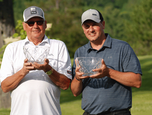 The Net Division winners were Ron (left) and Jason Luethmers.