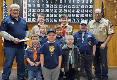 Post 202 Gambling Manager David Woodruff (left) presented the check to the Scouts and Cub Master Matt Shamp (right).