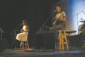 <p>Above: Rose Janzen (left) and Elena Goodrow perform at Salt Fest in the Social Circle Theater last Saturday to raise money for cystic fibrosis research.</p>