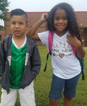 <p>Danny Rocha and Beronica Camejo start the third grade at Walker Park Elementary School in Monroe, Ga., on Wednesday, Aug. 1, 2018.</p>