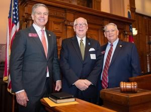 <p>Monroe native Harris Malcom, center, a state missionary with the Georgia Baptist Mission Board, was the Pastor for the Day in the state House of Representatives on Thursday, Jan. 16, 2020. Joining him in the House chamber are state Rep. Bruce Williamson of Monroe, left, and House Speaker David Ralston.</p>