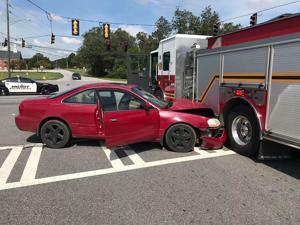Car hits fire truck