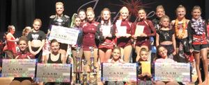 <p>Members of the different divisions who represented Love To Dance-Lisa Werner Studios are seen with their trophies and checks after winning multiple awards at the 2017 Inspire National Dance Competition in Savannah.</p>