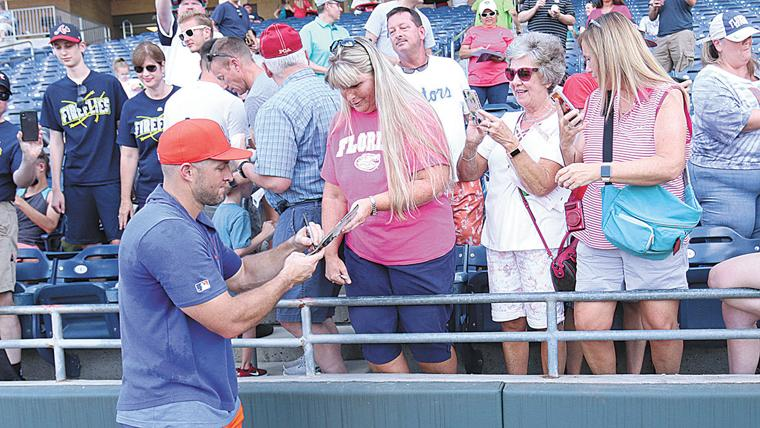 Tebow Signs for Fans