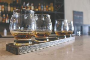 <p>A bourbon flight at South on Broad, one of the new restaurants in Monroe that serve beer, wine and liquor.</p>