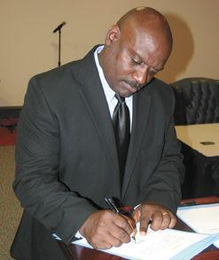 Norman Garrett Signs His Oath
