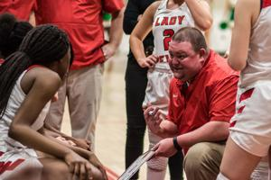 <p>Loganville girls basketball coach John Zorn talks with his players during a time out. Zorn picked up his 200th win as a head coach last week against Johnson of Gainesville.</p>