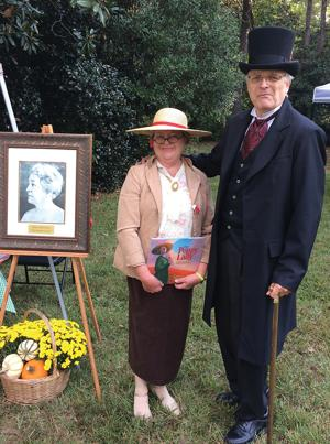 <p>Dianne Cown, left, dressed as Good Hope native Moina Michael at the Harris Homestead Festival. Al Stephens, right, another member of the Historical Society of Walton County, is dressed as Gov. Henry McDaniel, who was one of seven Georgia governors from Monroe.</p>