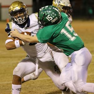 <p>Loganville Christian senior Jordan Jackson(2) fights for yardage Friday night, Nov. 22, 2019, but finds tough sledding against Pinewood Christian defender Parker Deal (15). Pinewood defeated LCA 42-0 in the second round GISA state playoff game at Bellville, Ga.</p>