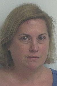 Teacher arrested outside school