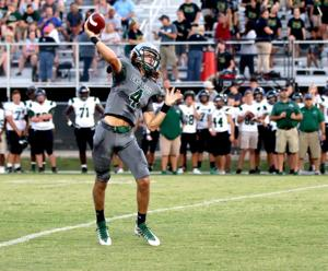 <p>Eastside senior quarterback Noah Cook launches a pass during the Eagles' 50-0 win over Walnut Grove in a scrimmage Friday, Aug. 16, 2019, at Sharp Stadium in Covington, Ga.</p>
