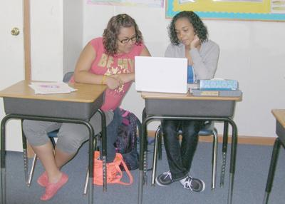 Students work together to complete class projects