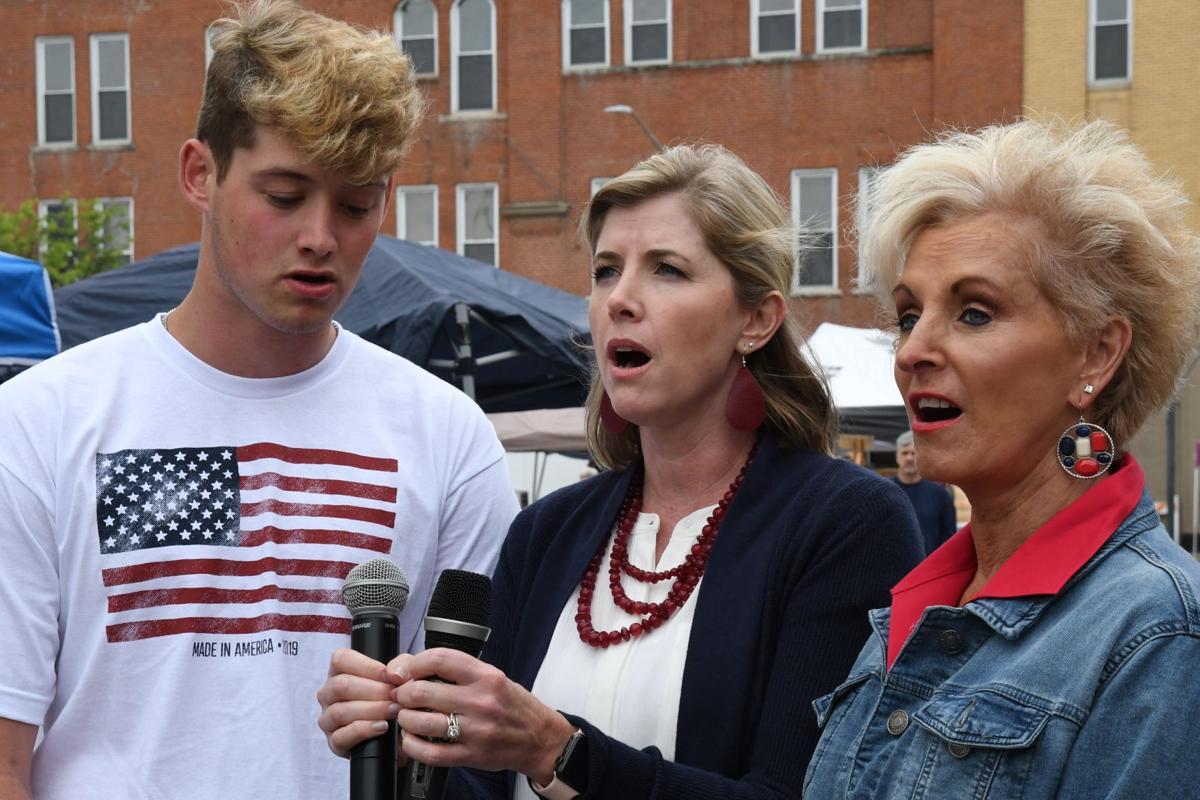 Bryce Browning, Sarah Browning and Vicki Bubalo (grandmother, mother, son) sing the national anthem.JPG