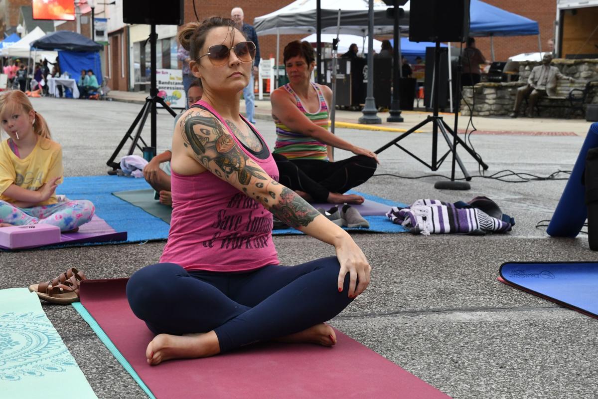 Debbie Rodimel, yoga instructor at Yoga on Maint St, leads a group yoga demonstration.JPG