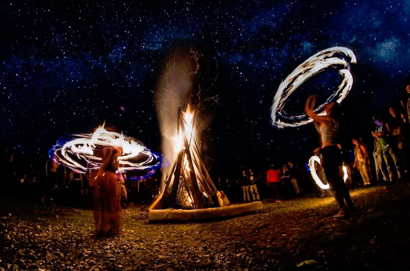 Fire spinners and night
