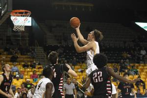 Appalachian State forward Griffin Kinney drives to the basket in the Mountaineers' 80-60 win over Belmont Abbey on Oct. 3. (Bill Sheffield / Watauga Democrat)
