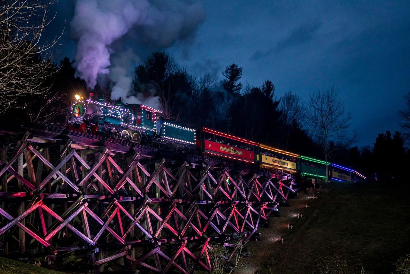 Tweetsie Christmas train steams across trestle
