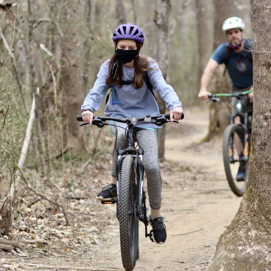 Watauga NICA rider Sophia Canu traverses a trail during practice.`
