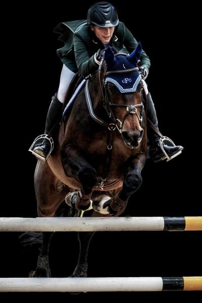 James Fisher, the Grand Prix's namesake, participates in horse jumping in his youth.