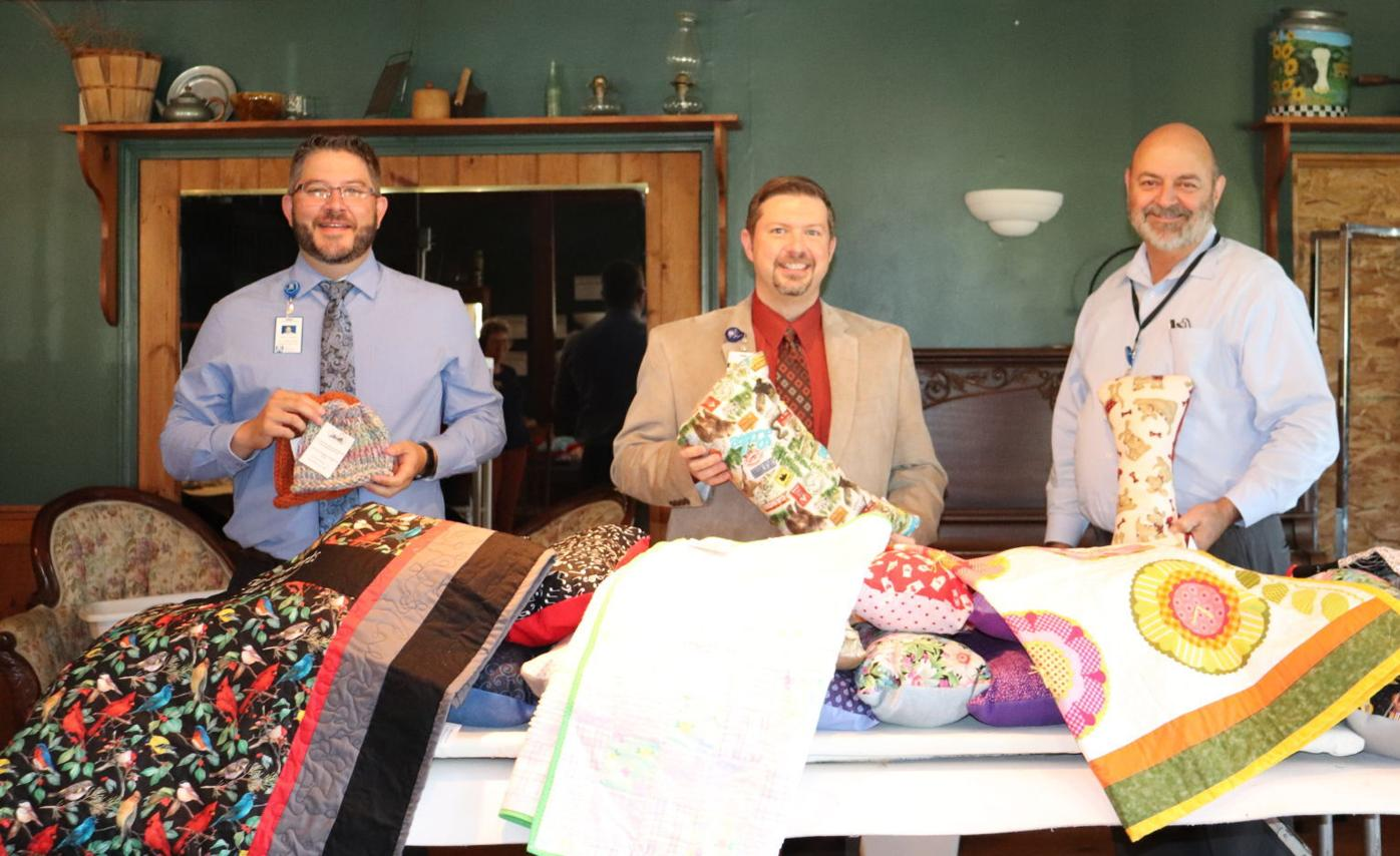 AMH staff with Material Girl donations