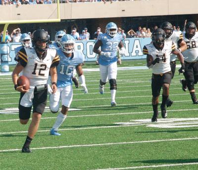 Thomas runs from the defense
