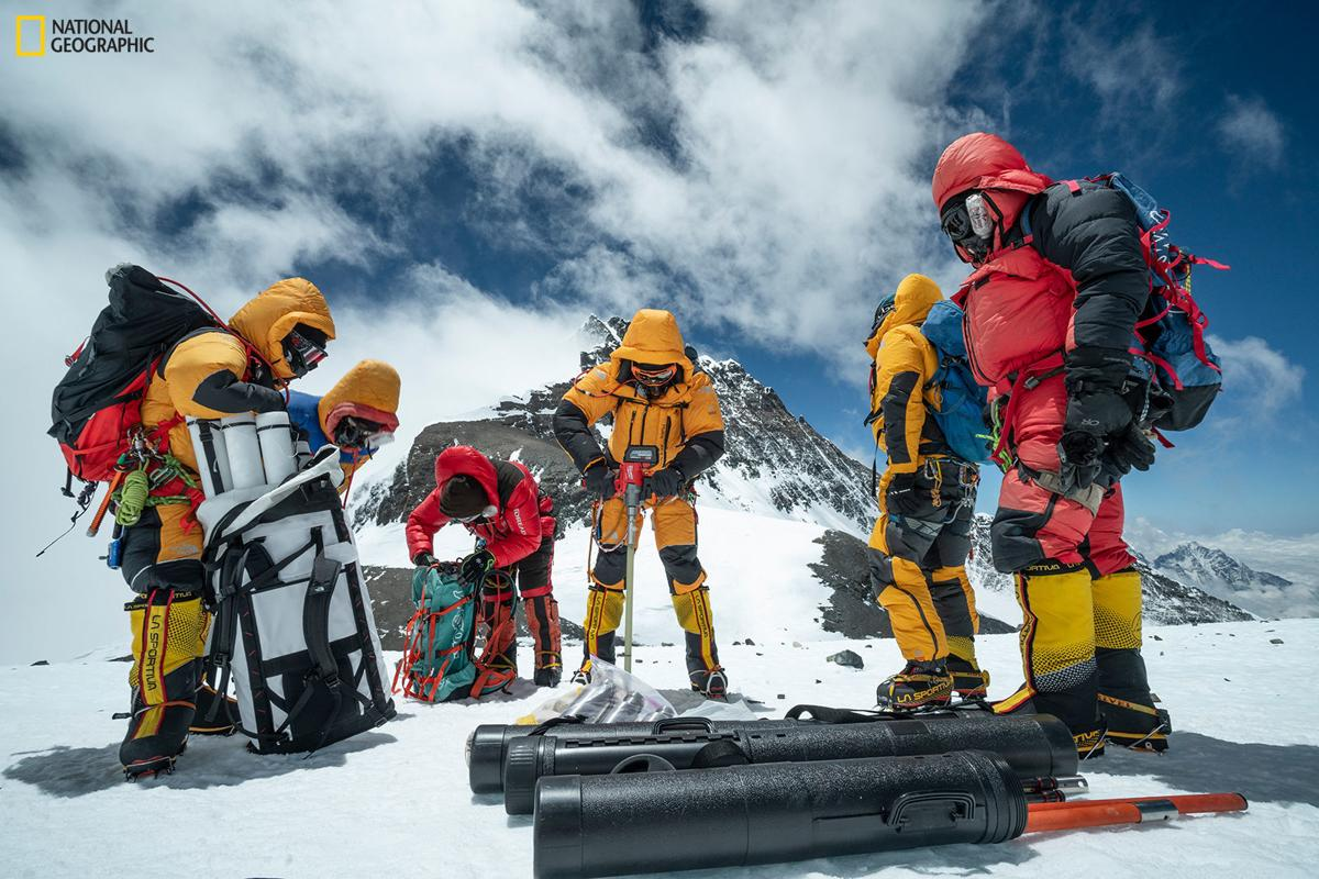 High-altitude expedition team drilling on Mt. Everest