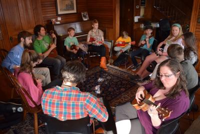 Ukulele class in parlor room