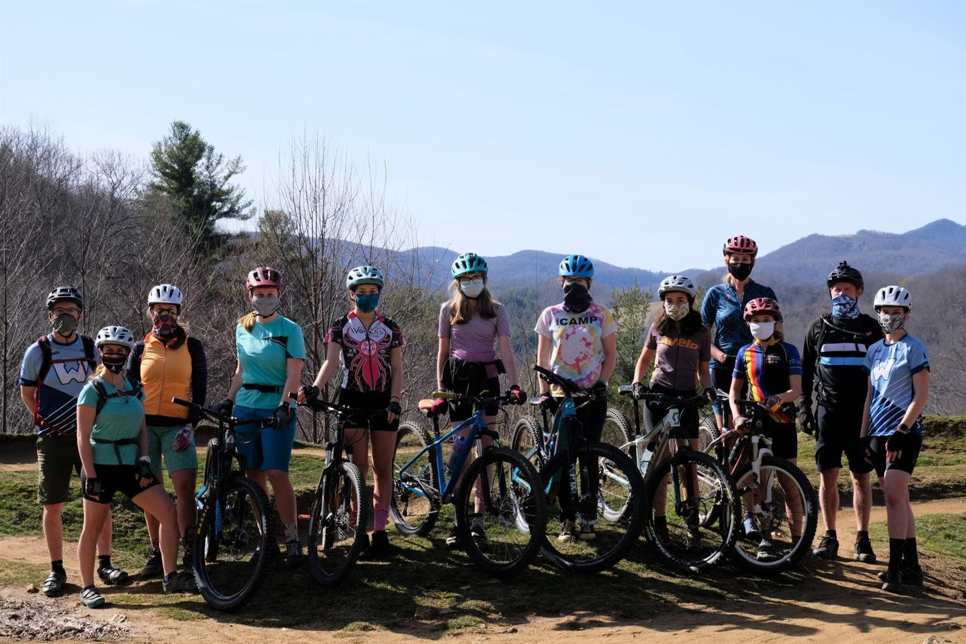 The advanced girls group of Watauga's NICA team and their coaches