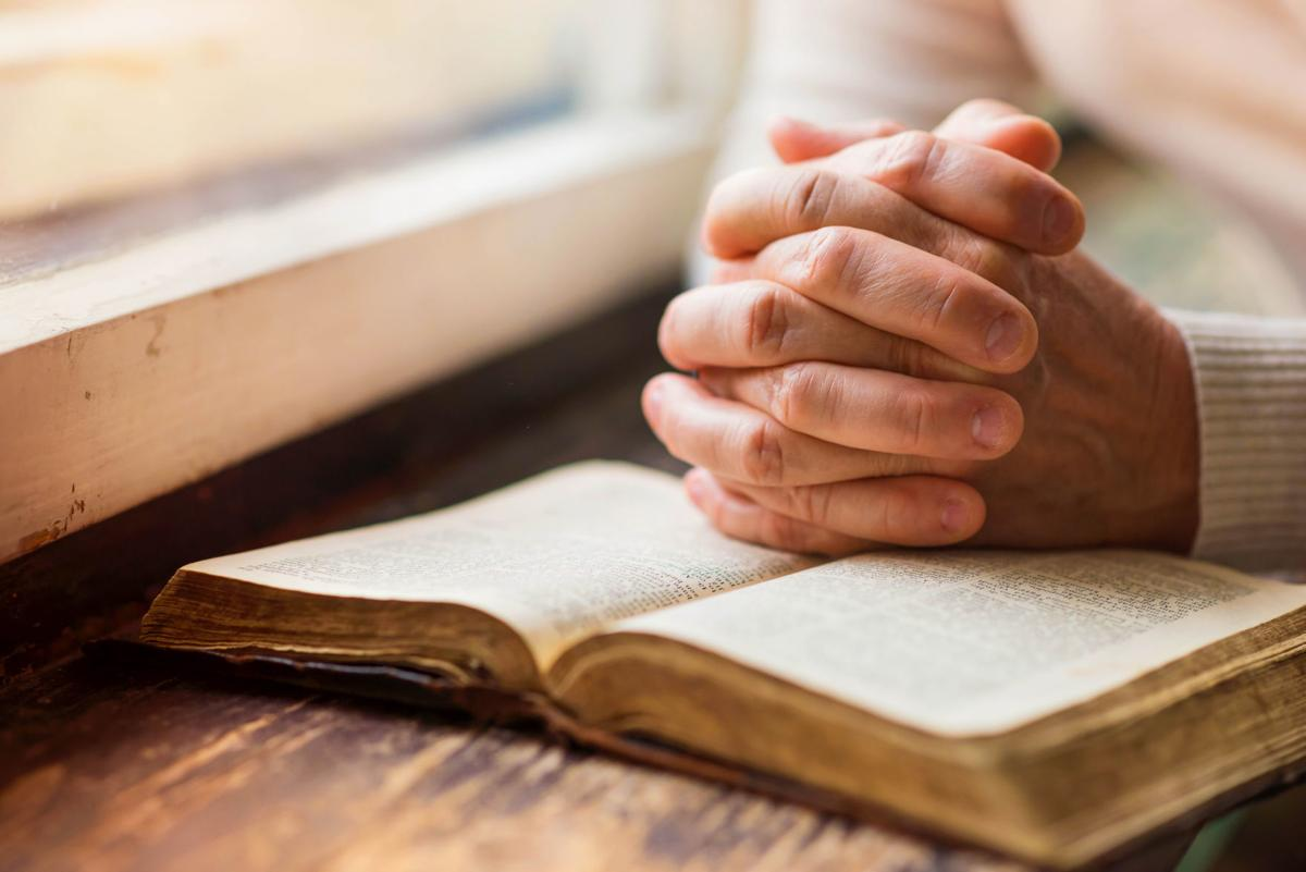 Praying on a Bible