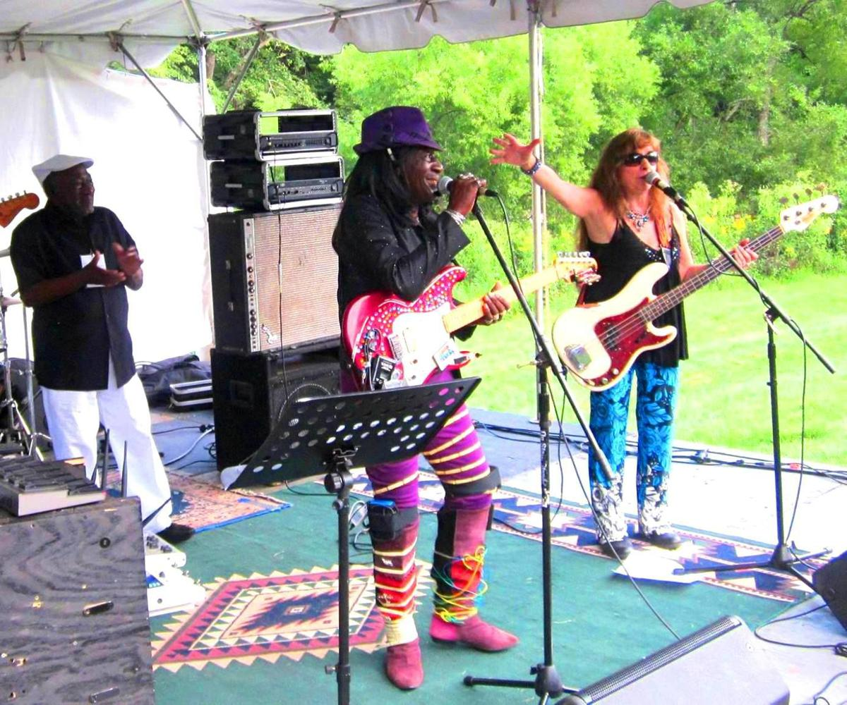 Val Woods and Queen Bee Zamagni pose for a photo together at the New River Blues Festival.