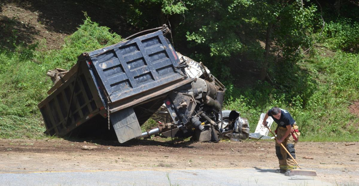 Man walks away with minor injuries after overturning dump truck