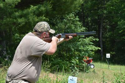Sawder Miller, shotgun instructor and member of the Ashe County Wildlife Club, aims down the range in Laurel Springs.