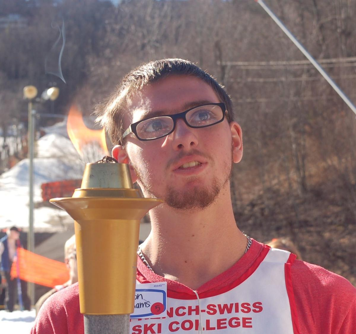 Williams with the torch