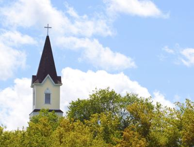 Church steeple above trees