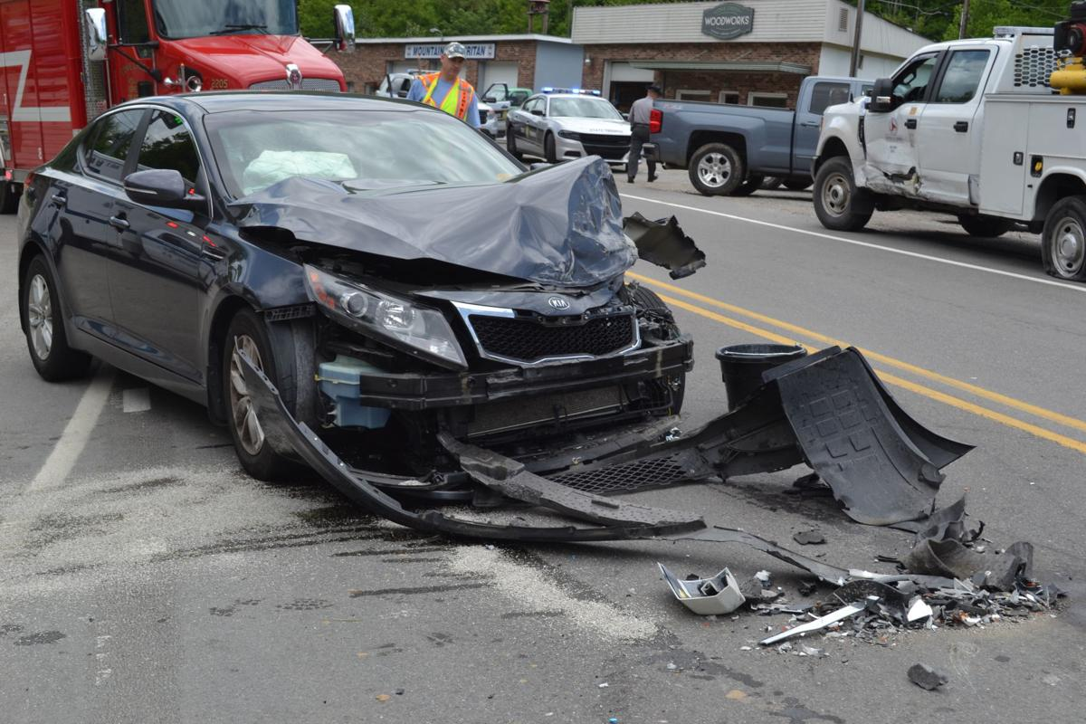 A Kia sustains heavy front end damage after colliding with an N.C. Department of Transportation vehicle on May 25.