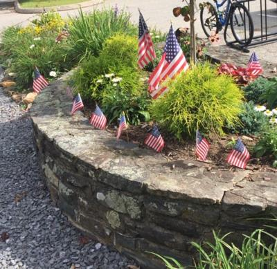 Greer Memorial Garden with American flags in 2018.