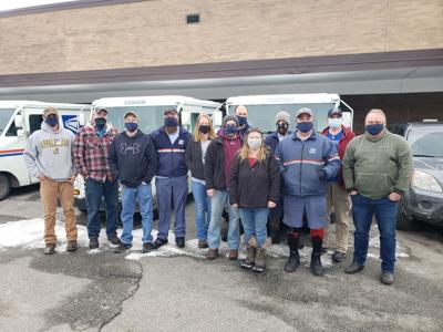 Mail carriers from the Boone Post Office