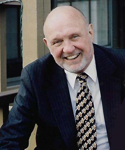 Dr. John E. Thomas