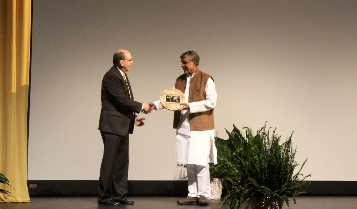 Kailash accepting award